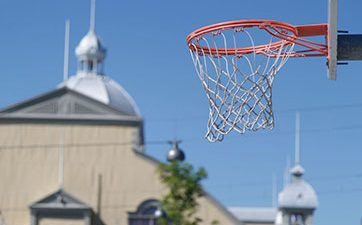 Image of a basketball net with the Aberdeen Pavilion in the background