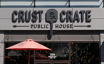 Image of the front door of Crust & Crate restaurant at TD Place