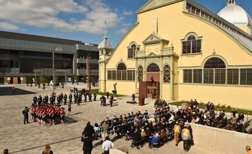 Image of a ceremony taking place in front of the Aberdeen Pavilion Event Square at TD Place