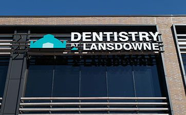 Image showing the the Dentistry at Lansdowne logo outside on the side of thebuilding at TD Place