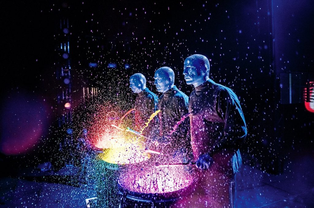Image of the Blue Man Group performing on stage at TD place